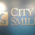 city smiles -lobby sign